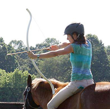 bareback rider practicing mounted archery