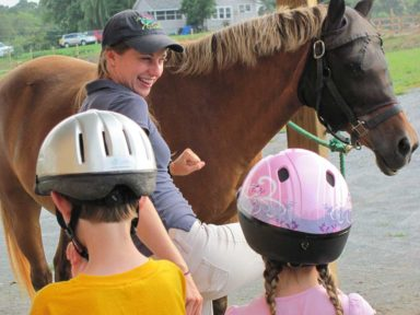 instructor showing two young students how pony defends her space bubble